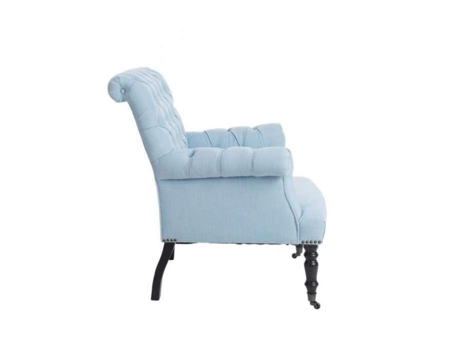 fauteuil capitonn bleu fauteuil chic pieds noirs. Black Bedroom Furniture Sets. Home Design Ideas