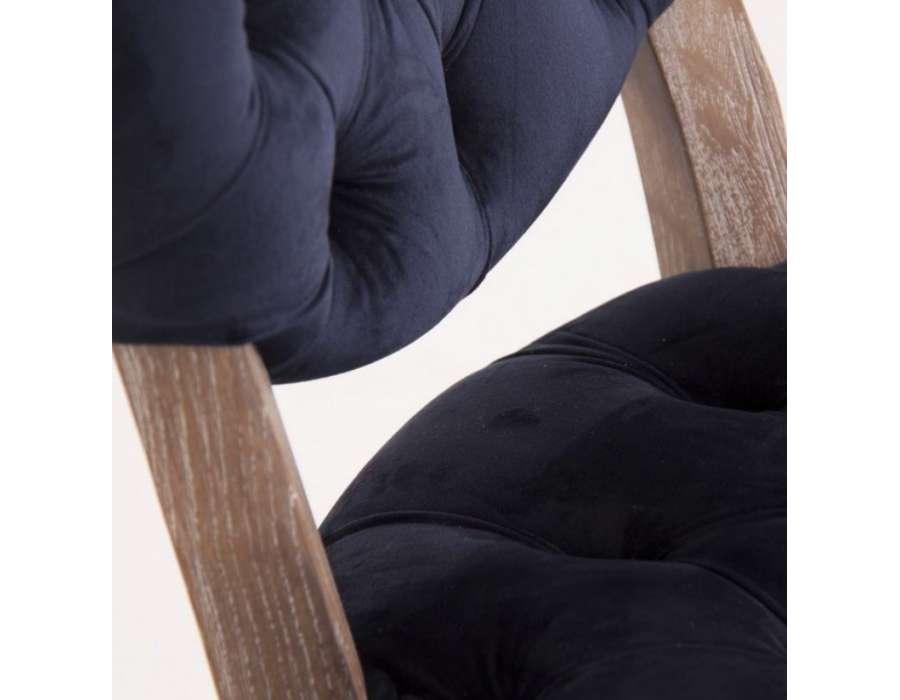 Chaise galbée capitonnée bleu marine