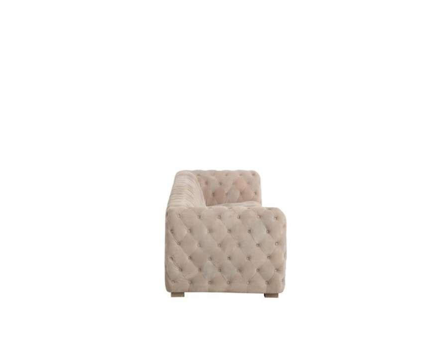 Canapé capitonné velours beige cubique