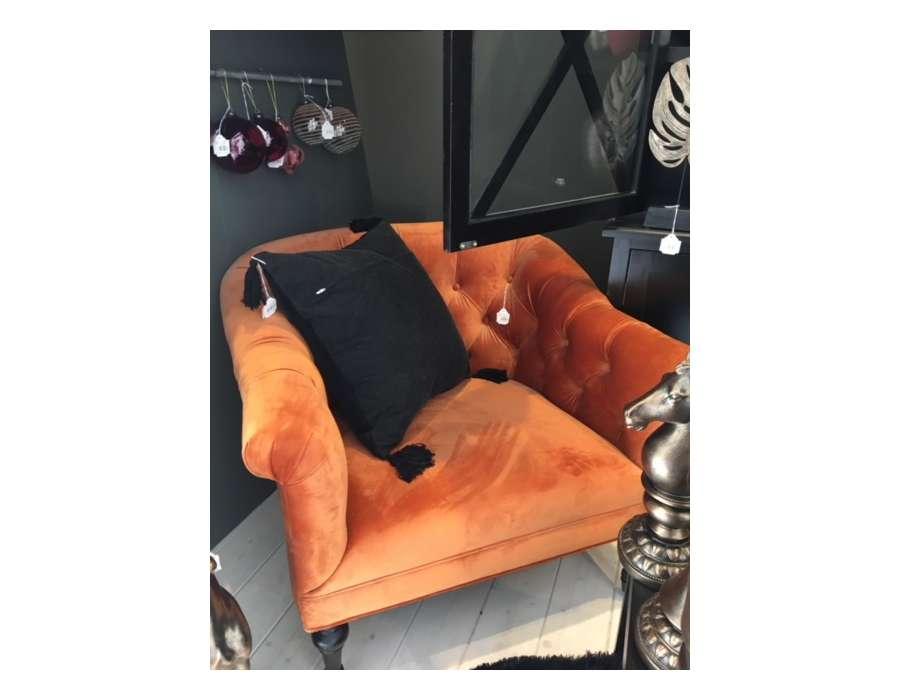 Fauteuil capitonné velours orange
