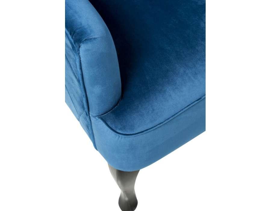 Fauteuil bleu dossier haut capitonné