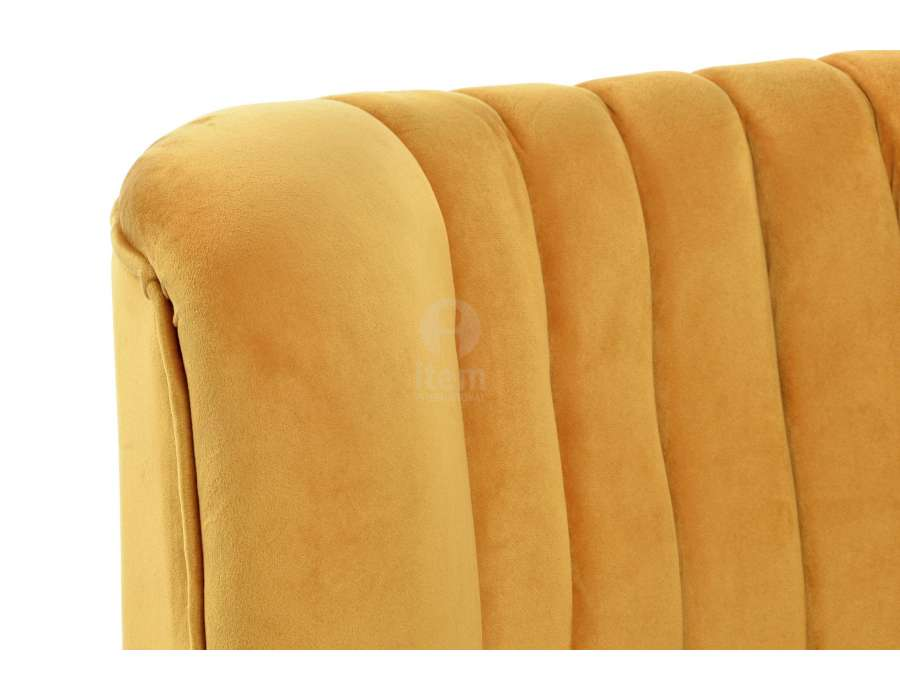 Fauteuil bas jaune en velours