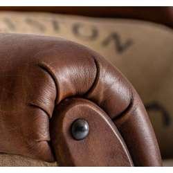 Fauteuil vintage cuir vieilli